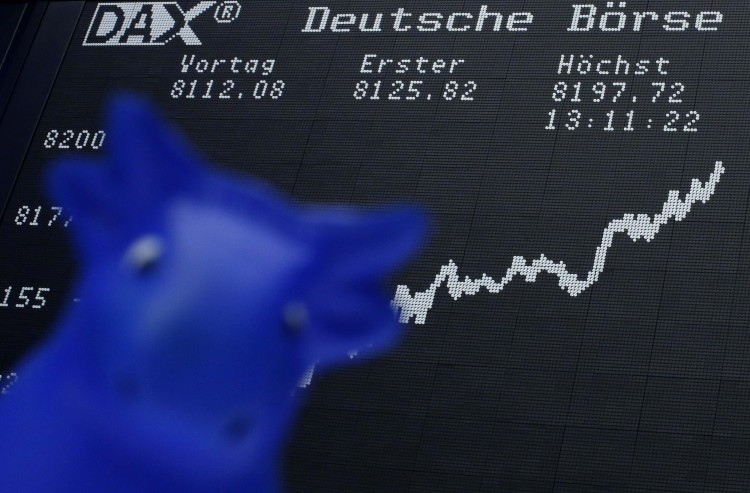 A bull figure is pictured in front of the German share price index DAX board at the German stock exchange in Frankfurt